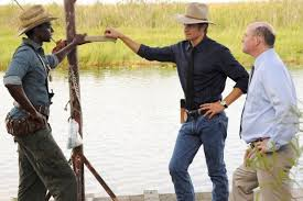 U.S. Marshall Raylan Givens (Timothy Olyphant) questions criminal advisor Jean Baptiste (Edi Gathegi) in the Series Five debut of 'Justified.'